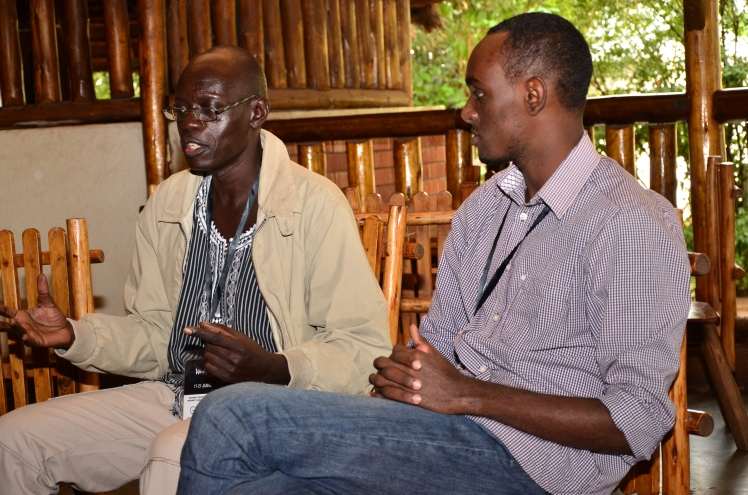 Kwezi Tabaro listens to Vukoni Lupa Lasaga at an Ubuntu Conversation session at the #Writivism2015 festival